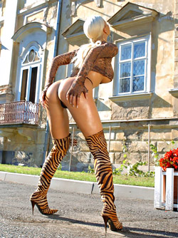 Awesome Luxury Bitch Kathy Lee Posing in her Tiger Print Boots